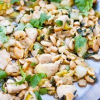 Image of Low Carb Bok Choy Chicken Stir Fry spread out on a silver tray.
