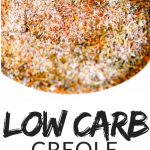 "PINTEREST IMAGE with words ""Low Carb Creole Seasoning Mix"" with Image of a bowl of Low Carb, low sodium Creole Seasoning Mix."