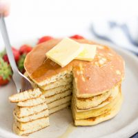 Image of Low Carb Pancakes with butter and syrup and a slice taken out on a fork.