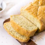 Low Carb Rosemary Bread loaf with a couple slices.
