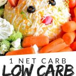 "PINTEREST IMAGE with words ""1 net carb low carb veggie dip"" with image of low carb veggie dip shaped like a cat."