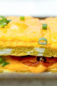 Layers of cheese and bacon in breakfast lasagna