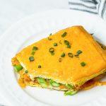 Slice of Breakfast lasagna on white plate