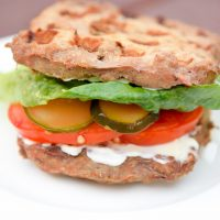 Waffle Iron Low Carb Burger Buns with lettuce, pickles, and tomato.