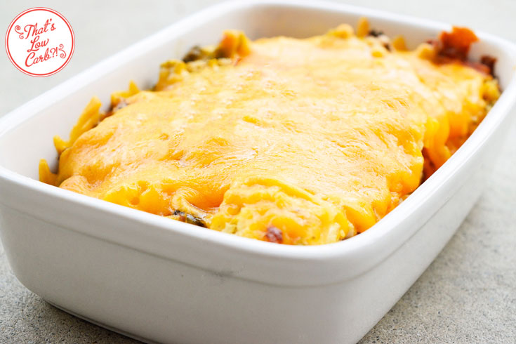 Low Carb Cheddar Broccoli Chicken Casserole Recipe ready to be cut and served from it's white casserole dish. The cheddar is hot and melty.