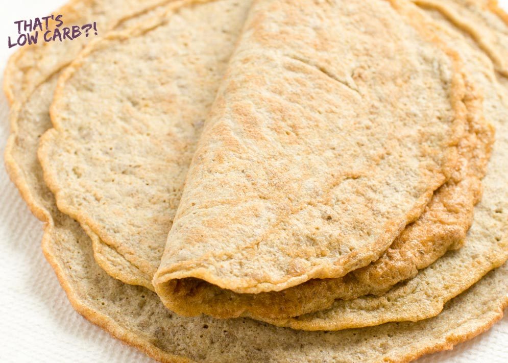 Close up shot of low carb keto tortillas stacked with top one folded in half.
