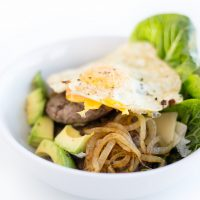 Healthy Big Mac Low Carb Salad with avocado, onion, and egg.