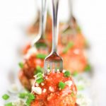 Image of Low Carb Keto Buffalo Meatballs lined up with green onion sprinkled over top.