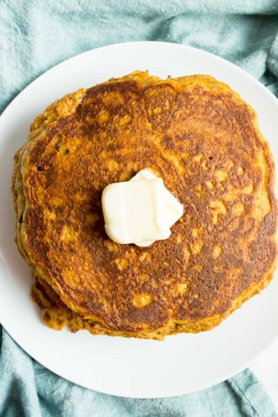 Overhead shot of low carb pumpkin pancakes on a white plate