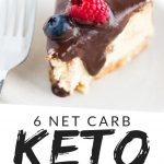 """PINTEREST IMAGE with words """"6 net carb Keto Cheesecake"""" Image of Keto Cheesecake slice with chocolate sauce over top and raspberry and blueberry."""