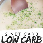 "PINTEREST IMAGE with words ""2 net carb low carb sausage gravy"" with image of Low Carb Keto Sausage Gravy in a pot with spoon sticking out."