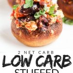 "PINTEREST IMAGE with words ""2 net carb low carb stuffed mushrooms"" with image of Low Carb keto Stuffed Mushrooms with olives, tomato. and feta."