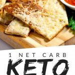"""PINTEREST IMAGE with words """"1 net carb keto garlic bread"""" with image of Keto Low Carb Garlic Bread on a wood cutting board"""