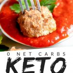 """PINTEREST IMAGE with words """"0 net carbs keto meatballs"""" with image of Easy Keto Meatballs No Carb Meatball on a fork being dipped in red sauce."""