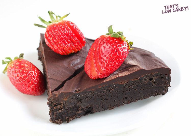 Image of Keto Flourless Chocolate Cake slices with strawberries on top.