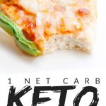 """PINTEREST IMAGE with words """"1 net carb keto chicken crust pizza"""" with image of keto chicken crust pizza slice with green pepper on top and a bite missing."""