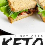 "PINTEREST IMAGE with words "" 1 net carb keto bread"" with image of keto bread sandwich sliced in half on a white plate with bacon and lettuce showing."