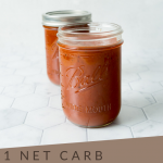 Pinterest Image with jar of bbq sauce and with text '1 Net Carb Keto BBQ Sauce'
