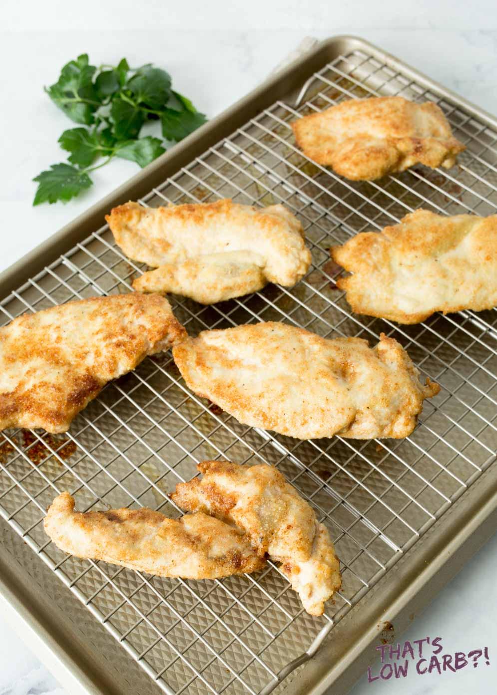 Crispy Keto Chicken Breasts on drying rack