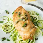 Keto Chicken Piccata over zooodles on white plate