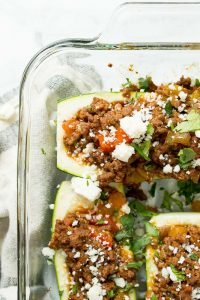 Zucchini Taco Boats in a casserole dish with lime wedges beside