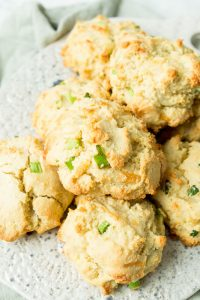 Cheddar Bay Biscuits piled on a cutting board